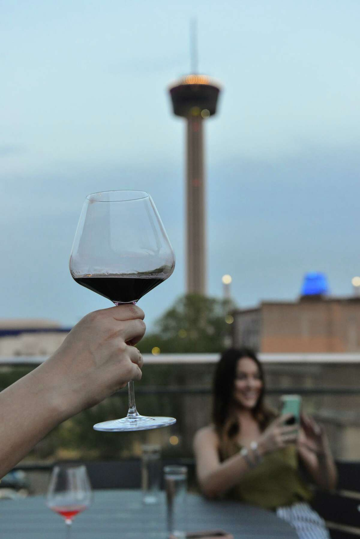 People enjoy evening drinks at the Fairmount Rooftop Oyster Bar.