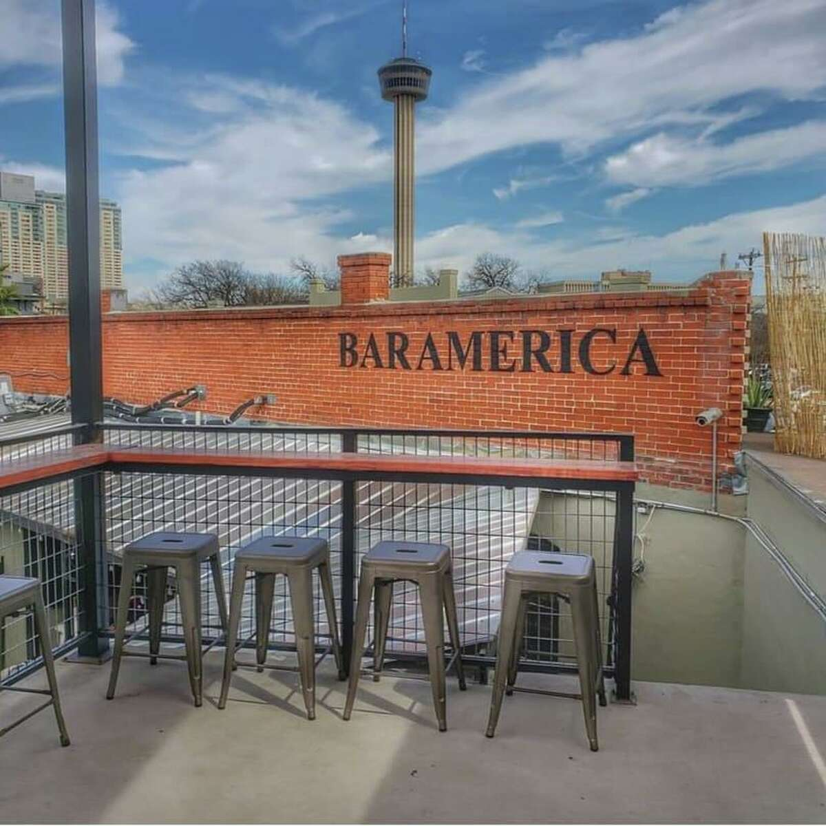 The rooftop bar space at Bar America in Southtown features a view of Hemisfair.