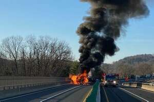 The scene of a fiery tractor-trailer rollover crash on eastbound I-84 on the Southbury-Newtown border the morning of Tuesday, March 30, 2021.