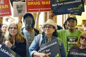 Advocates rally at the Capitol to demand marijuana legalization at the Capitol in Albany.