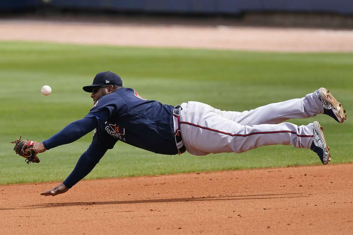 Atlanta Braves first baseman Pablo Sandoval makes a diving attempt for a ball hit for a single by Tampa Bay Rays' Brandon Lowe during a spring training baseball game Sunday, March 21, 2021, in Port Charlotte, Fla. (AP Photo/John Bazemore)