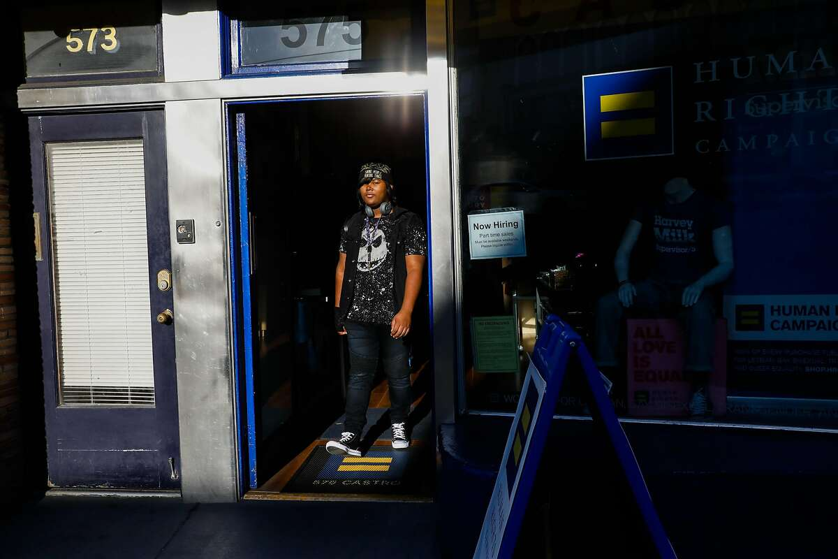 Kat exits the Human Rights Campaign store in the Castro in 2019. Kat lived in one of the first shelter-transitional housing programs in the U.S. for transgender youths in San Francisco.