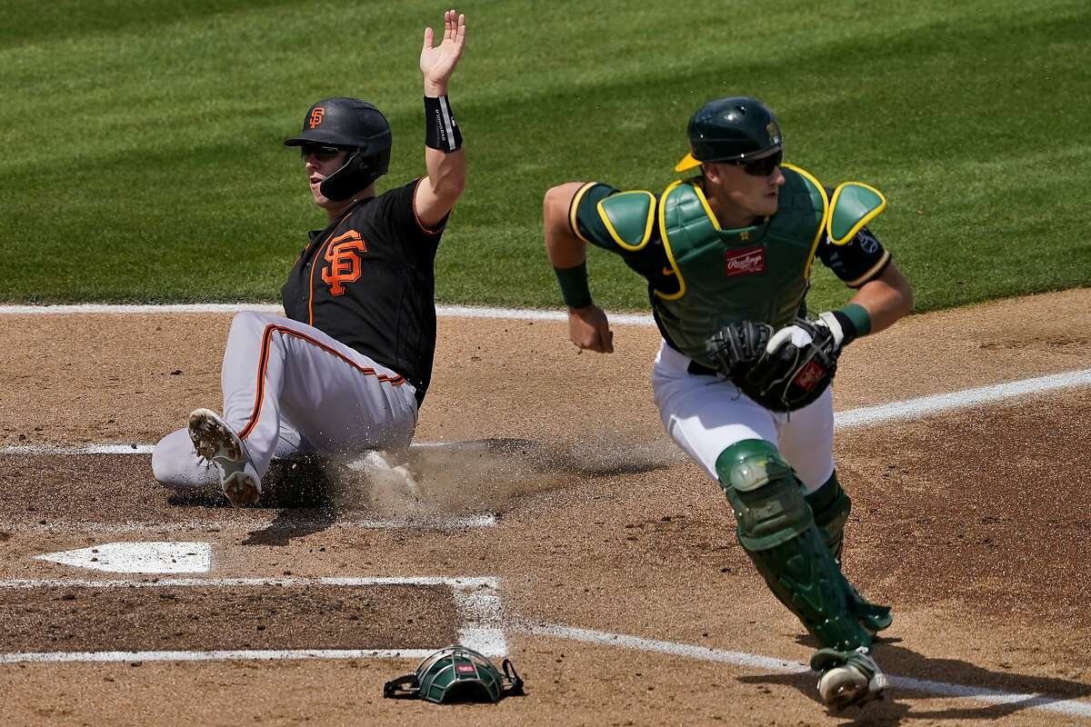 """The Giants' Buster Posey, scoring on a hit by Mauricio Dubon against the A's on Monday, said """"We've got a lot of really good baseball players offensively, defensively and pitching."""""""