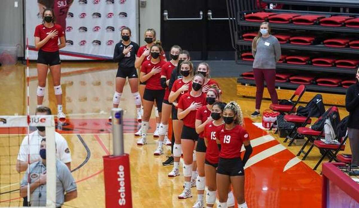 Members of the SIUE volleyball stand for the National Anthem before the start of a match inside Vadalabene Center this season.