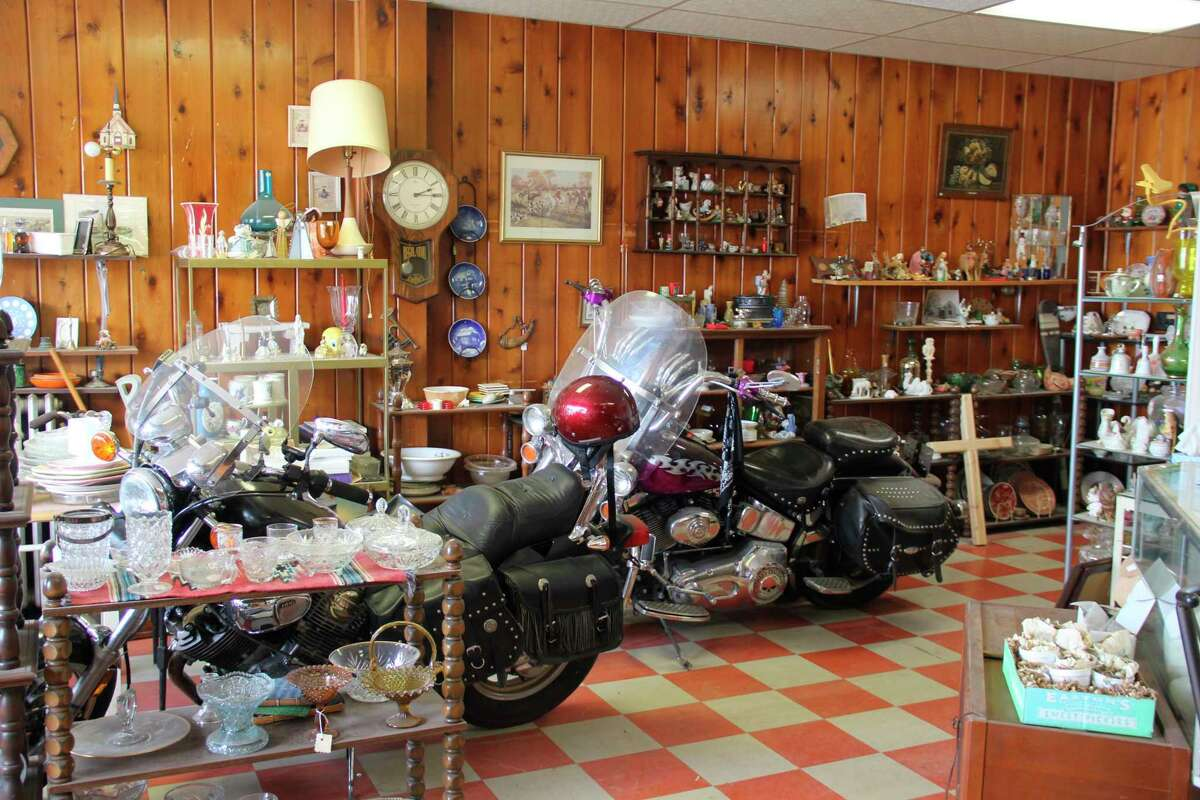 There are a number ofantiques available out front at the Crooked River Trading Company. (Robert Creenan/Huron Daily Tribune)