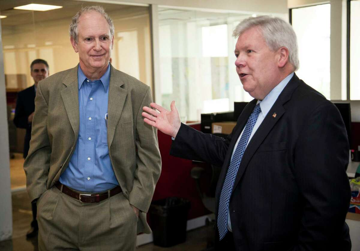 Steve Riley, left, is named the Houston Chronicle's new executive editor by John McKeon, publisher and Hearst Texas Newspapers president, on Thursday, May 2, 2019, in Houston. Riley has served as acting editor since Oct. 30, 2018 and was previously the deputy managing editor, investigations, beginning in November 2017, overseeing a team of reporters and a data editor. Before that, he spent more than 30 years at The News & Observer in Raleigh, North Carolina, in roles including: senior editor for investigations, deputy managing editor, metro editor, sports editor, government editor and reporter. He also worked as a reporter in Mississippi for the Clarion-Ledger in Jackson, The Sun in Gulfport and the Northeast Mississippi Daily Journal in Tupelo. His investigative teams have won more than a dozen national awards. Riley fills the role vacated by Nancy Barnes, who departed in November to become senior vice president of news for National Public Radio.