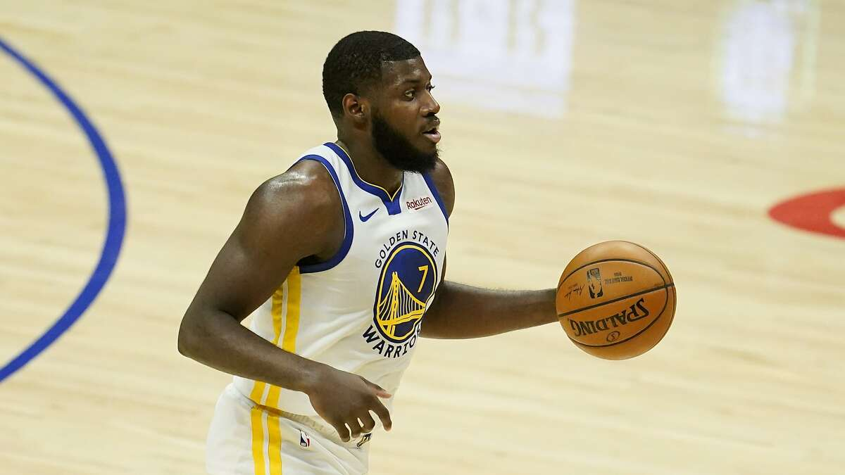 Golden State Warriors forward Eric Paschall (7) dribbles during an NBA basketball game against the Los Angeles Clippers Thursday, March 11, 2021, in Los Angeles. (AP Photo/Marcio Jose Sanchez)