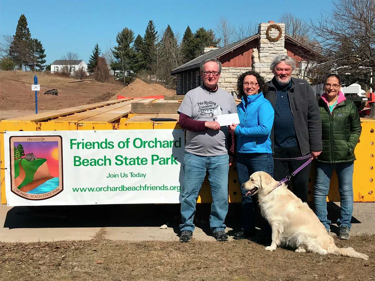 Karen Goodman,husband Daryl Goodman and daughter Elizabeth Johnson,present a family donation to Ed Kolanowski (left), Friends ofOrchard Beach State Park Board member, to support thegroup's Playground Project at Orchard Beach State Park.Daryl and Karen Goodman are local residents and professional mental health practitioners who share a lifetime commitment to mental health and wellness in community. KarenGoodman also is the Manistee County Board of Commissioners vice-chair.(Courtesy photo)