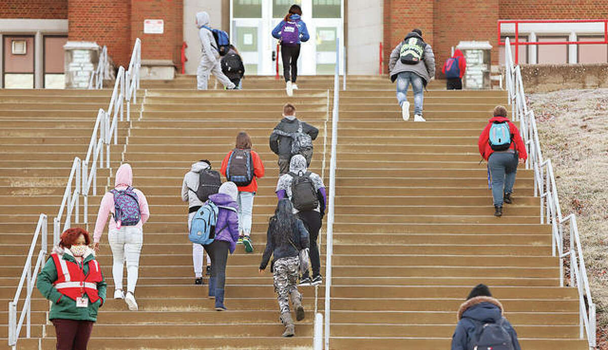 Students make the trek up the many stairs to the Main Building at Alton Middle School on College Avenue on Jan. 19. On Wednesday, Gov. J.B. Pritzker announced 27 school districts in the five-county area will receive a combined $175 million in federal funding over the next three years.