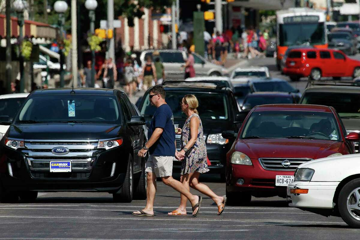 Pedestrians make their way in downtown San Antonio in 2016. An effort to improve safety for pedestrians appears to have stalled in the Texas Legislature. Demand a hearing.