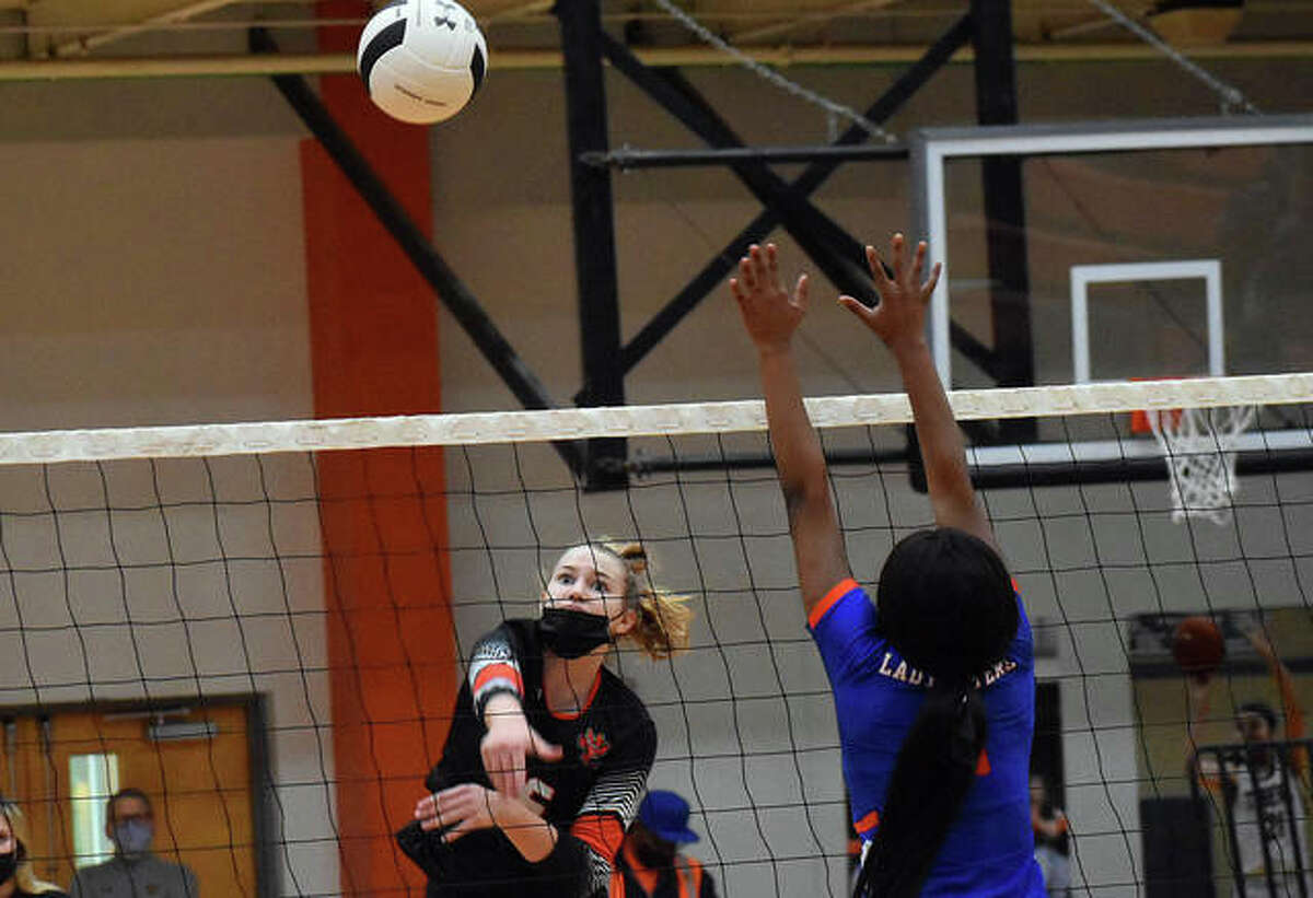 Edwardsville's Isabella O'Day watches as one of her seven kills sails over the net in the first game against East St. Louis on Tuesday in Edwardsville.
