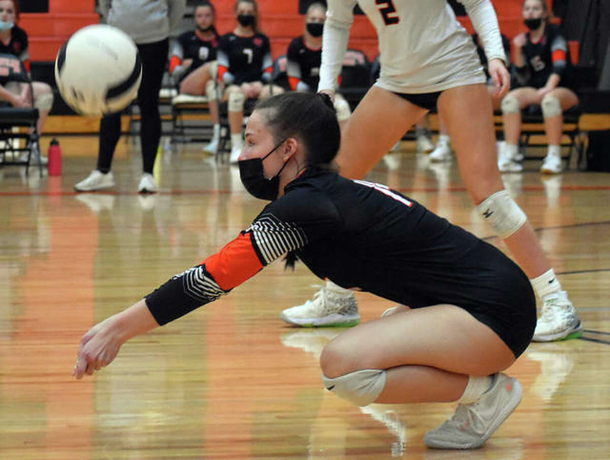 Edwardsville's Sydney Davis successfully receives a serve during the first game against East St. Louis on Tuesday in Edwardsville.