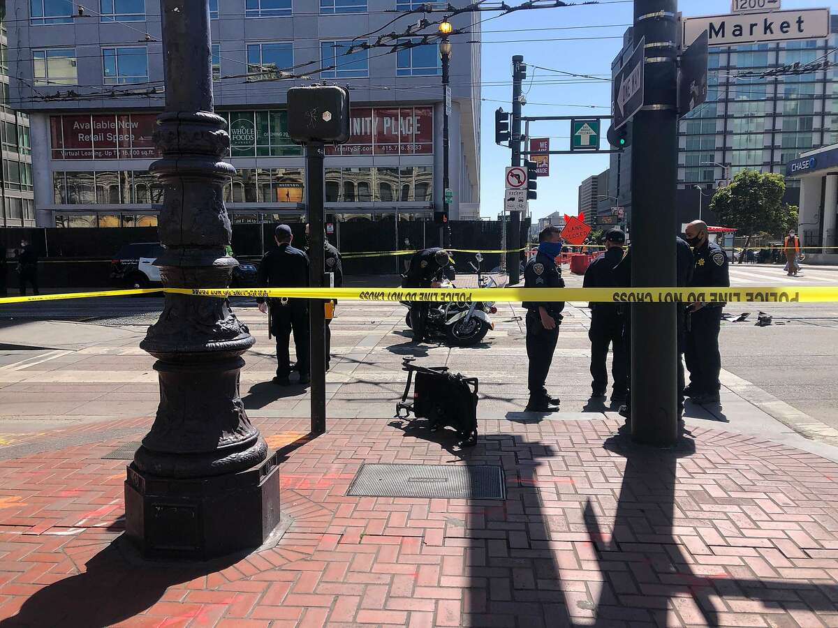 San Francisco police officers at the scene of a crash at Hyde and Market streets on Wednesday, March 31, 2021.