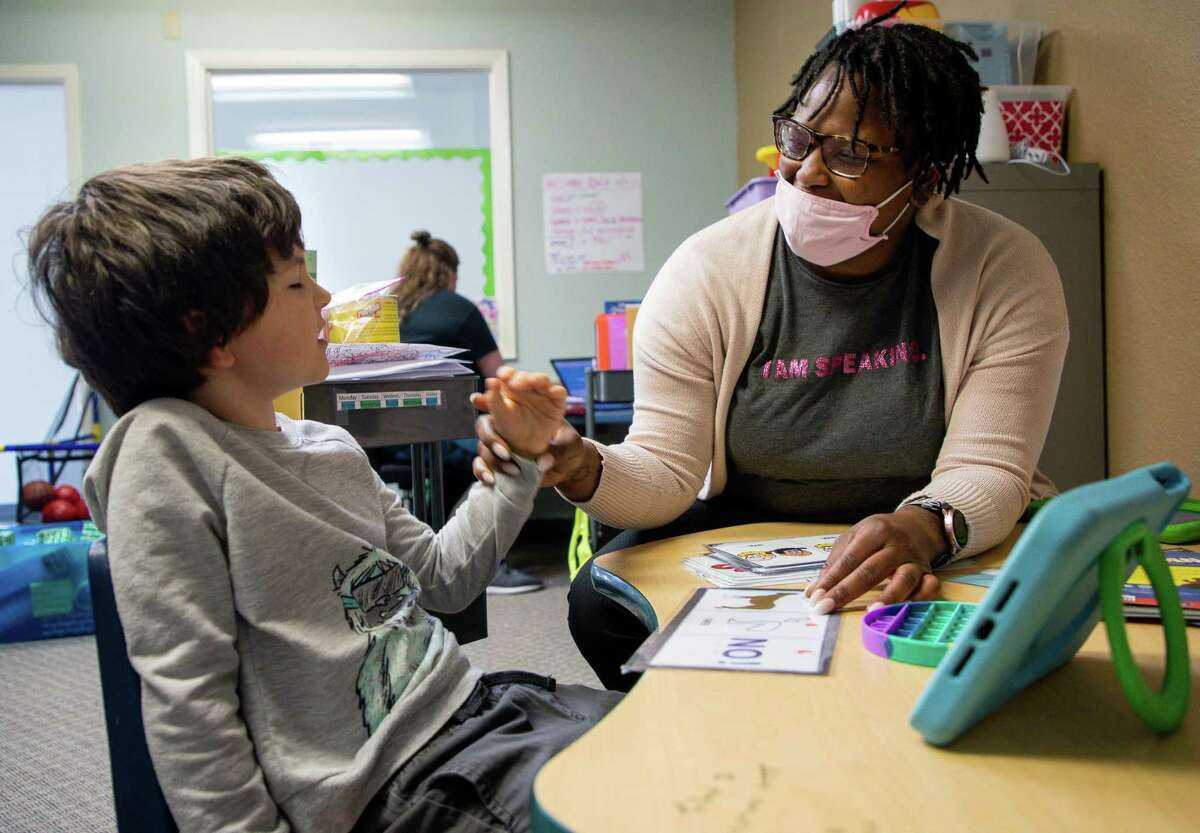 Registered behavior technician Tamara Harbert works with Ben Neel to pronounce words at Texas Autism Academy in The Woodlands. Texas Autism Academy is a nonprofit private school with a 7:2 student-teacher ratio.