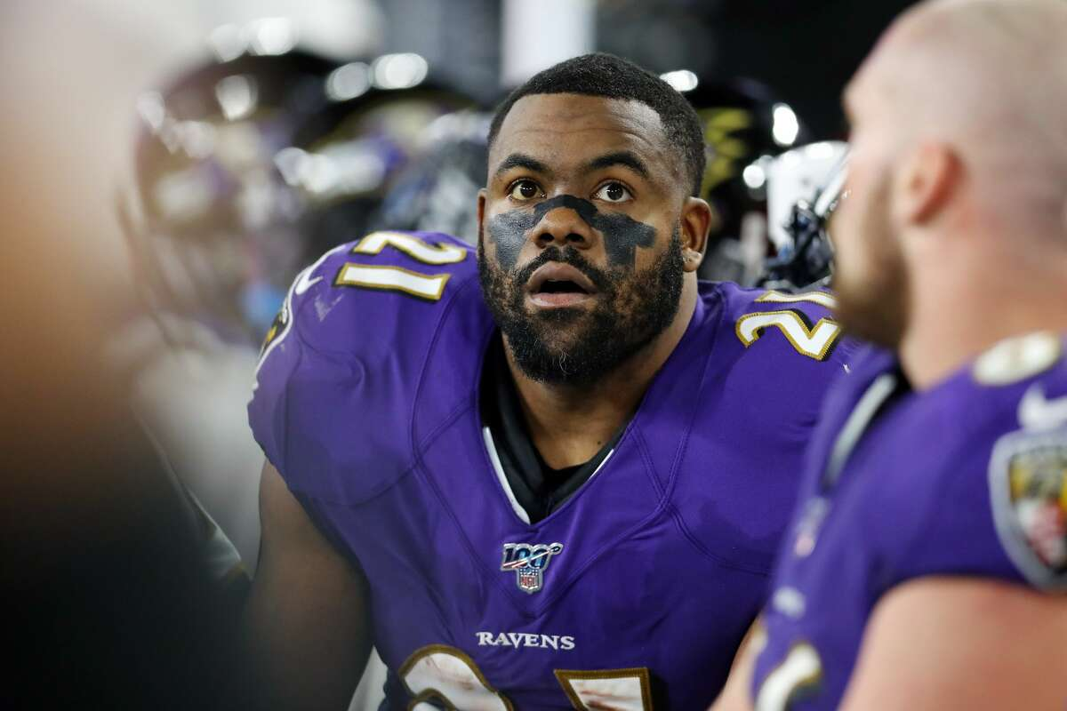 BALTIMORE, MARYLAND - JANUARY 11: Mark Ingram II #21 of the Baltimore Ravens reacts on the sideline during the AFC Divisional Playoff game against the Tennessee Titans at M&T Bank Stadium on January 11, 2020 in Baltimore, Maryland. (Photo by Maddie Meyer/Getty Images)