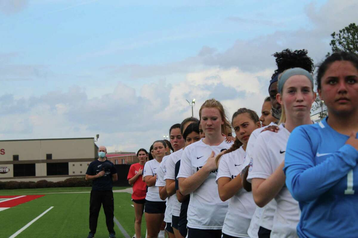 First year Atascocita coach Brittany McCloskey talking with her Lady Eagles befor their area round match against Clear Lake at Galena Park ISD Stadium.