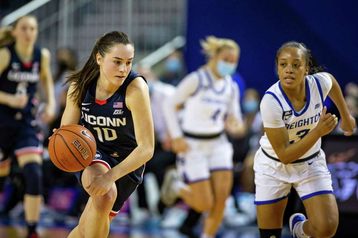 UConn guard Nika Muhl dribbles the ball against Creighton guard DeArica Pryor during a game in February.