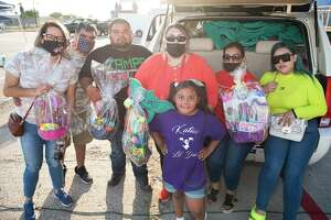 Vendors Yvonne Solis, Daniel Solis, Carlos Paredes, event organizer Mimi Espinoza, Katie Espinoza, Elvira Almanza and Ashley Espinoza gather for a photo with Easter baskets collected as donations Saturday, March 27, 2021 for entry to El Dorado Flea Market for an entertainment event featuring wrestling, a car show and music.