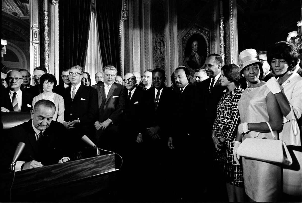 President Lyndon Johnson signed the Voting Rights Act in the President's Room as Martin Luther King Jr. and other civil rights leaders look on, August 6, 1965. LBJ Library photo by Yoichi Okamoto