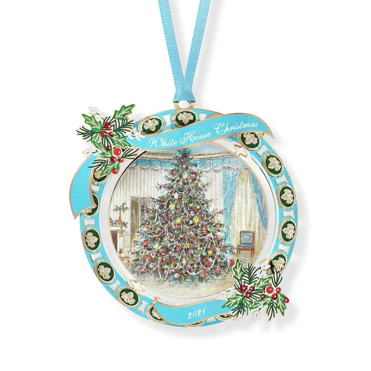 """The 2021 White House Christmas ornament depicts a Christmas tree in the White House Blue Room that was the front of the 1967 White House Christmas card. A quote from former President Lyndon Johnson is on one side of the ornament: """"Our mission is at once the oldest and the most basic of this country: to right wrong, to do justice, to serve man."""""""