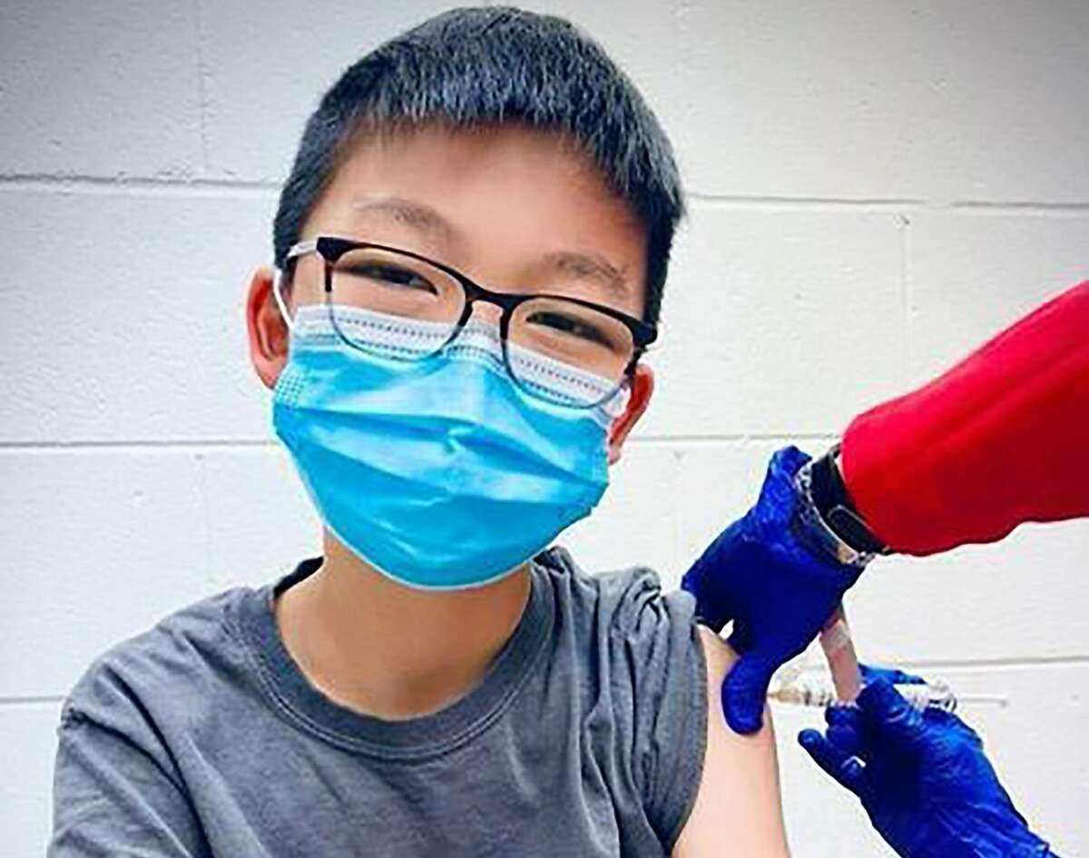 Caleb Chung receives the first dose of Pfizer coronavirus vaccine or placebo, as a trial participant for children ages 12 to 15, at Duke University Health System in Durham, N.C.