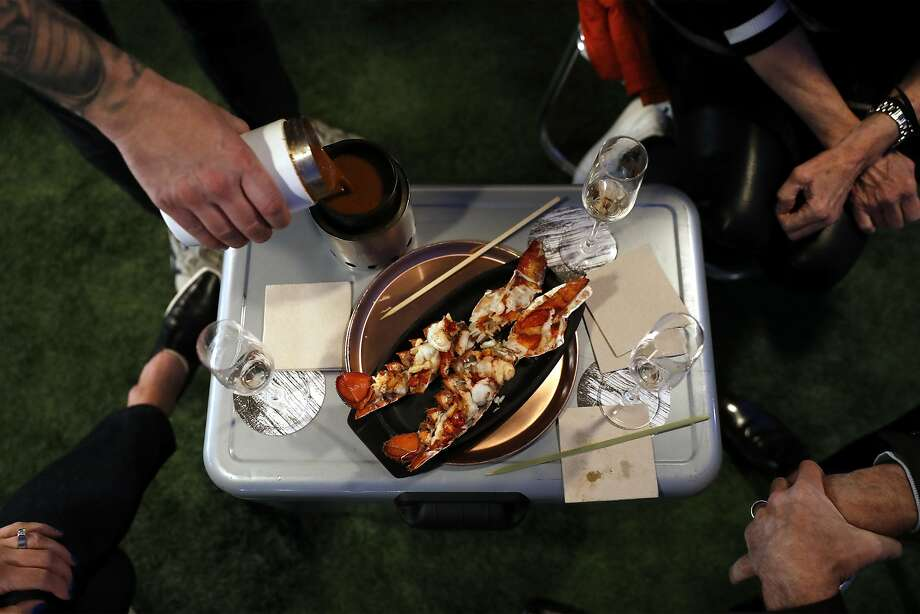Strong serves Maine lobster with fondue during a private meal outside SuperStella, a 1989 camper van he converted into a mobile dining room in San Francisco. Photo: Scott Strazzante / The Chronicle