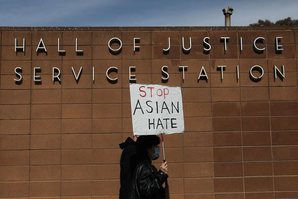 Elaine Qi of S.F. marches on Bryant Street on Thursday against Asian hate.