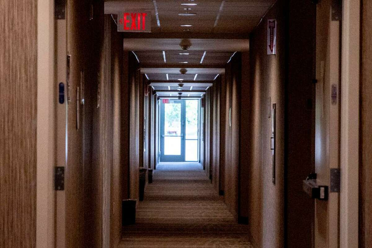 An empty hall of rooms is seen at an undisclosed hotel housing the homeless during the COVID-19 pandemic in the Bay Area, Calif. Thursday, August 6, 2020. The race is on to get in on the first round of applications for $100 million in Project Homekey funding to covert hotels in the Bay Area into permanent homeless housing such as this one.