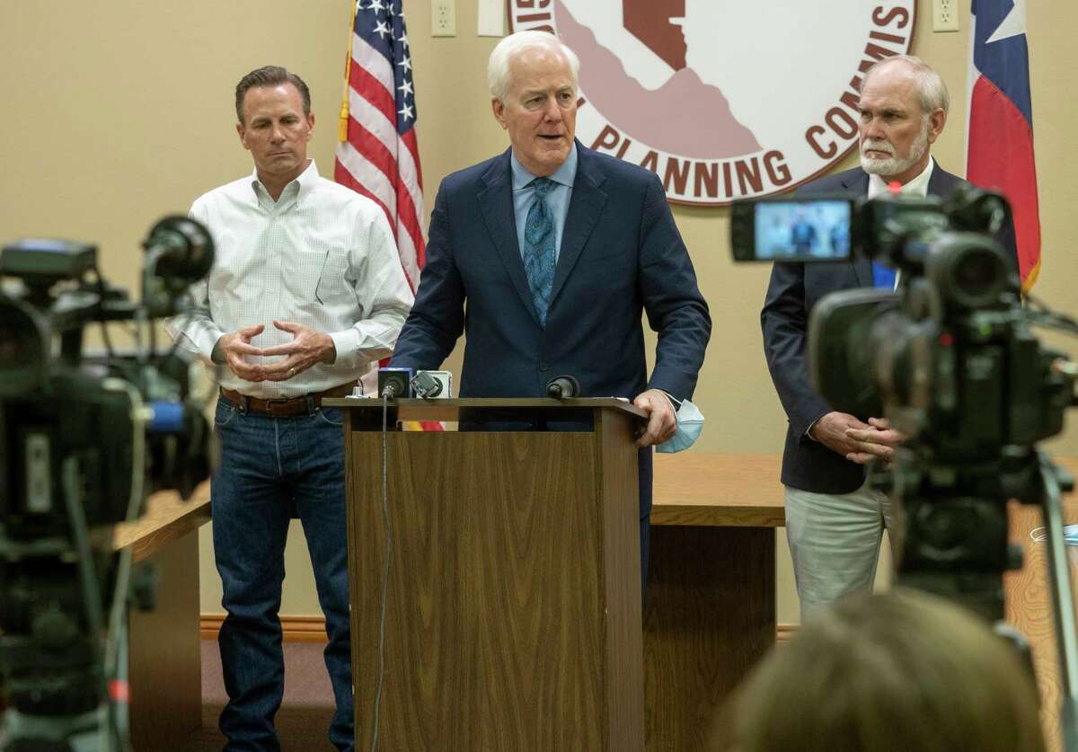 Sen John Cornyn talks with the media following a tour of the local migrant housing facility with Midland County Judge Terry Johnson and Mayor Patrick Payton 03/31/21 during a press conference at the Permian Basin Regional Planning Commission. Tim Fischer/Reporter-Telegram