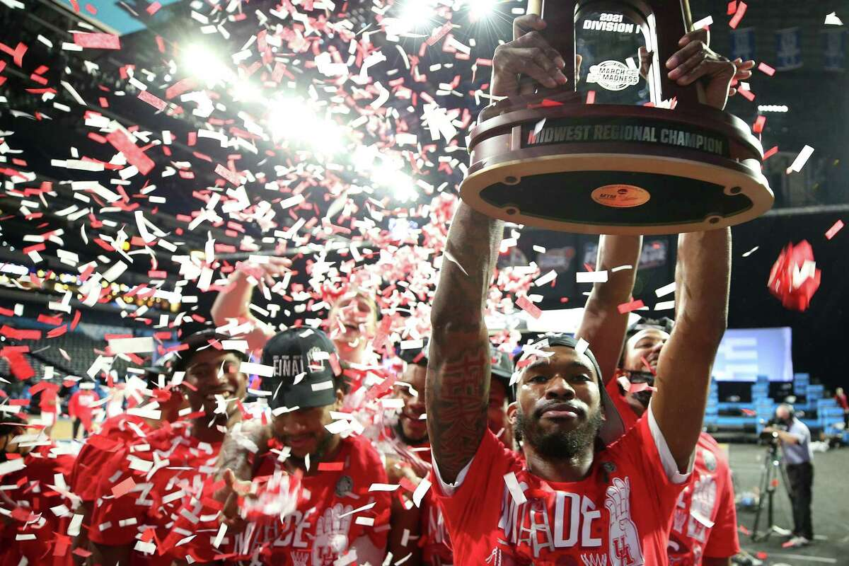 DeJon Jarreau, No. 3 of the Houston Cougars, hoists the Midwest Regional Champion trophy after defeating the against the Oregon State Beavers in the Elite Eight round of the 2021 NCAA Men's Basketball Tournament at Lucas Oil Stadium on March 29, 2021 in Indianapolis, Indiana.