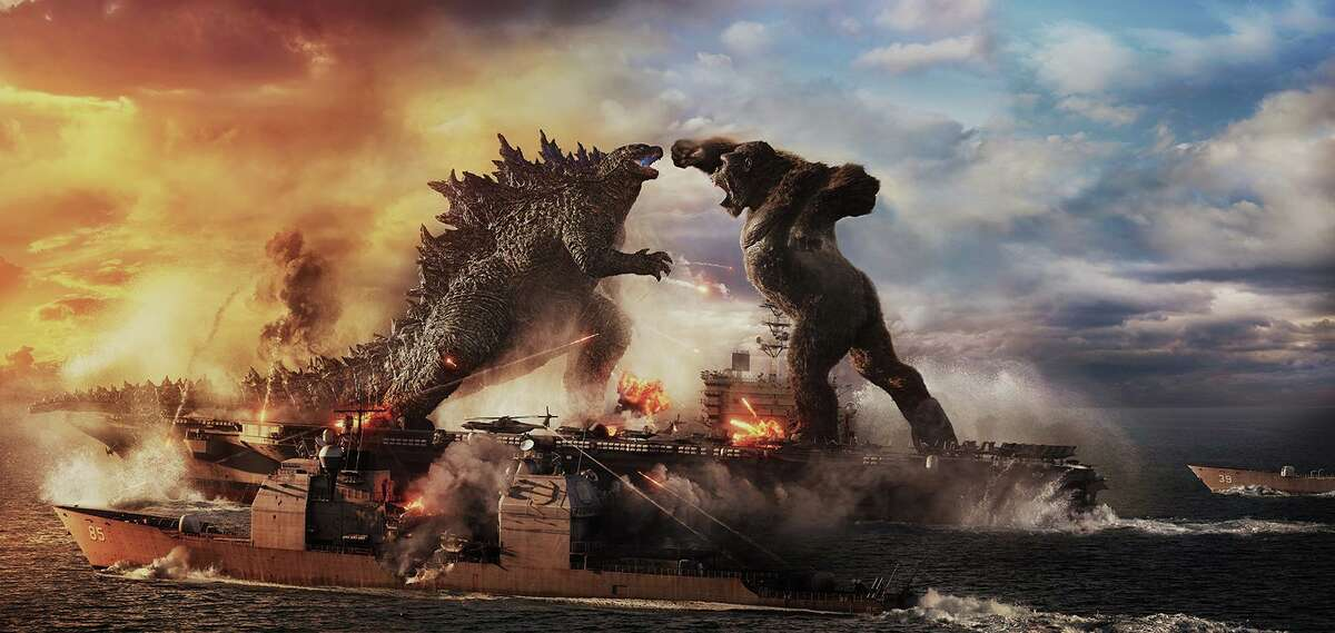 """Godzilla battles Kong in Warner Bros. Pictures' and Legendary Pictures' action adventure """"Godzilla vs. Kong."""" (Courtesy of Warner Bros. Pictures/TNS)"""