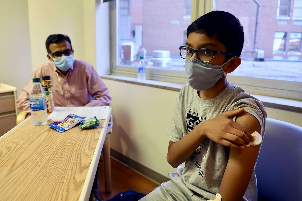 In a photo provided by Cincinnati Children's Hospital, Abhinav, 12, was a participant in the Pfizer vaccine trial at Cincinnati Children?•s Hospital in October 2020. The Pfizer-BioNTech coronavirus vaccine is extremely effective in young adolescents, perhaps even more so than in adults, the companies reported on Wednesday. The data have not yet been reviewed by independent experts. (Cincinnati Children's Hospital via The New York Times) -- NO SALES; FOR EDITORIAL USE ONLY WITH NYT STORY VACCINE ADOLESCENTS BY APOORVA MANDAVILLI FOR MARCH 31, 2021. ALL OTHER USE PROHIBITED. --