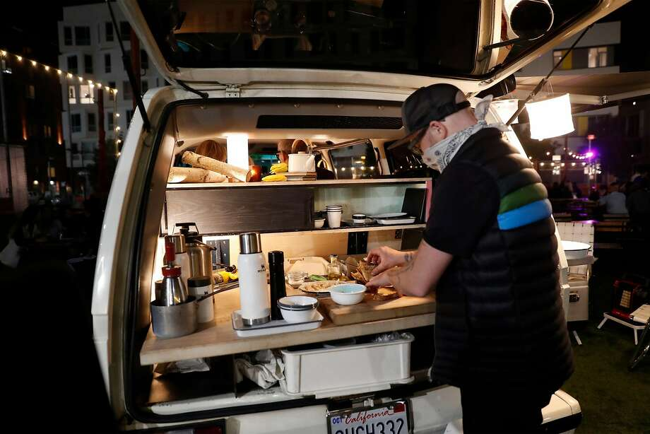 Strong prepares a private meal for three in Stella, a 1989 camper van he converted into a mobile dining room in San Francisco. Photo: Scott Strazzante / The Chronicle