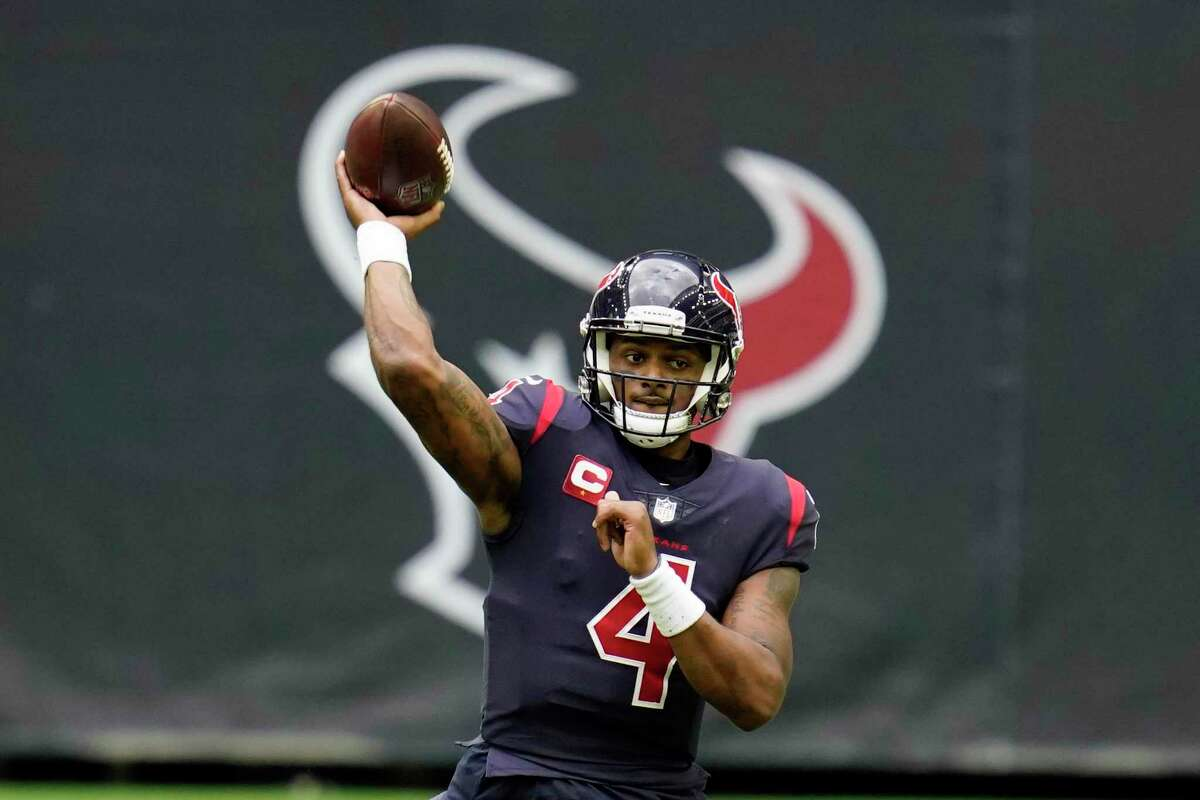 FILE - In this Dec. 27, 2020, file photo, Houston Texans quarterback Deshaun Watson throws a pass during an NFL football game against the Cincinnati Bengals in Houston. New Houston Texans coach David Culley reiterated Thursday, March 11, 2021, that the team has no intention of trading Watson, despite the star quarterback's request to be dealt. (AP Photo/Matt Patterson, File)