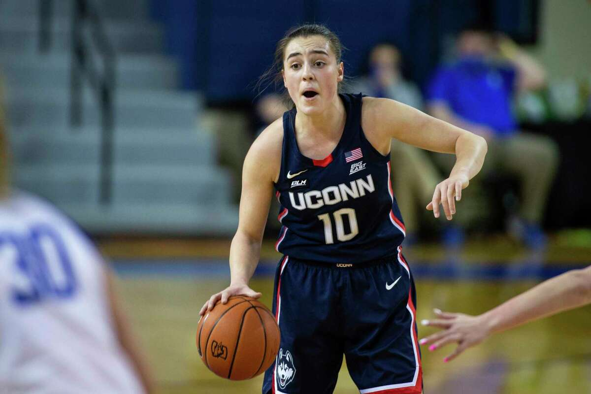 UConn guard Nika Muhl dribbles the ball against Creighton during a game in February.