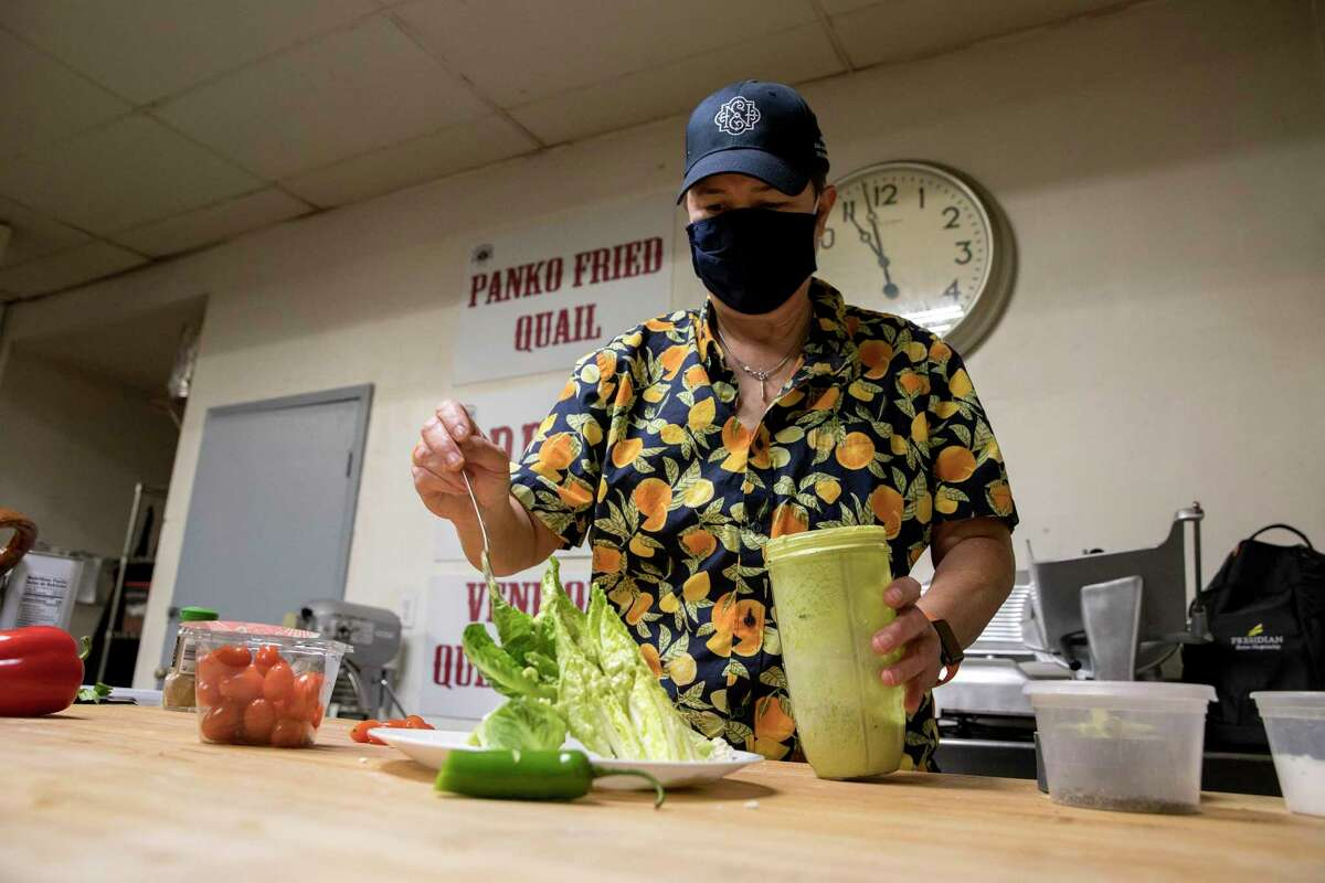 Heather Nañez, the executive chef at Lazo With Don Strange, which is slated to open at the luxury hotel Estancia del Norte this spring, makes an avocado Caesar salad in the test kitchen.