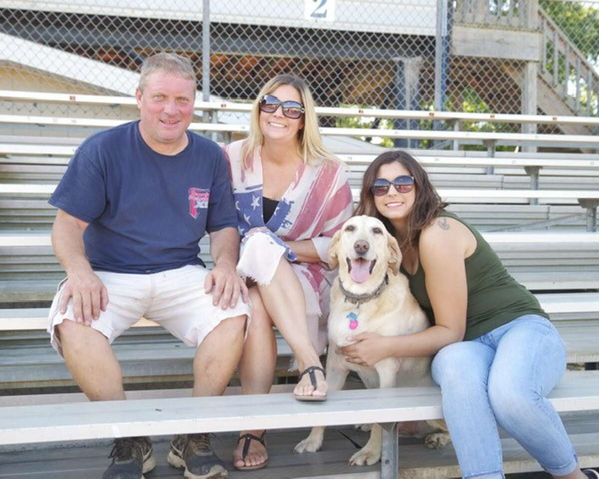 Lyle DeVore, the promoter at Albany-Saratoga Raceway, with his fiancee Marcy Mangino, her daughter Mia Mangino and Roscoe. (Mark Brown photos)