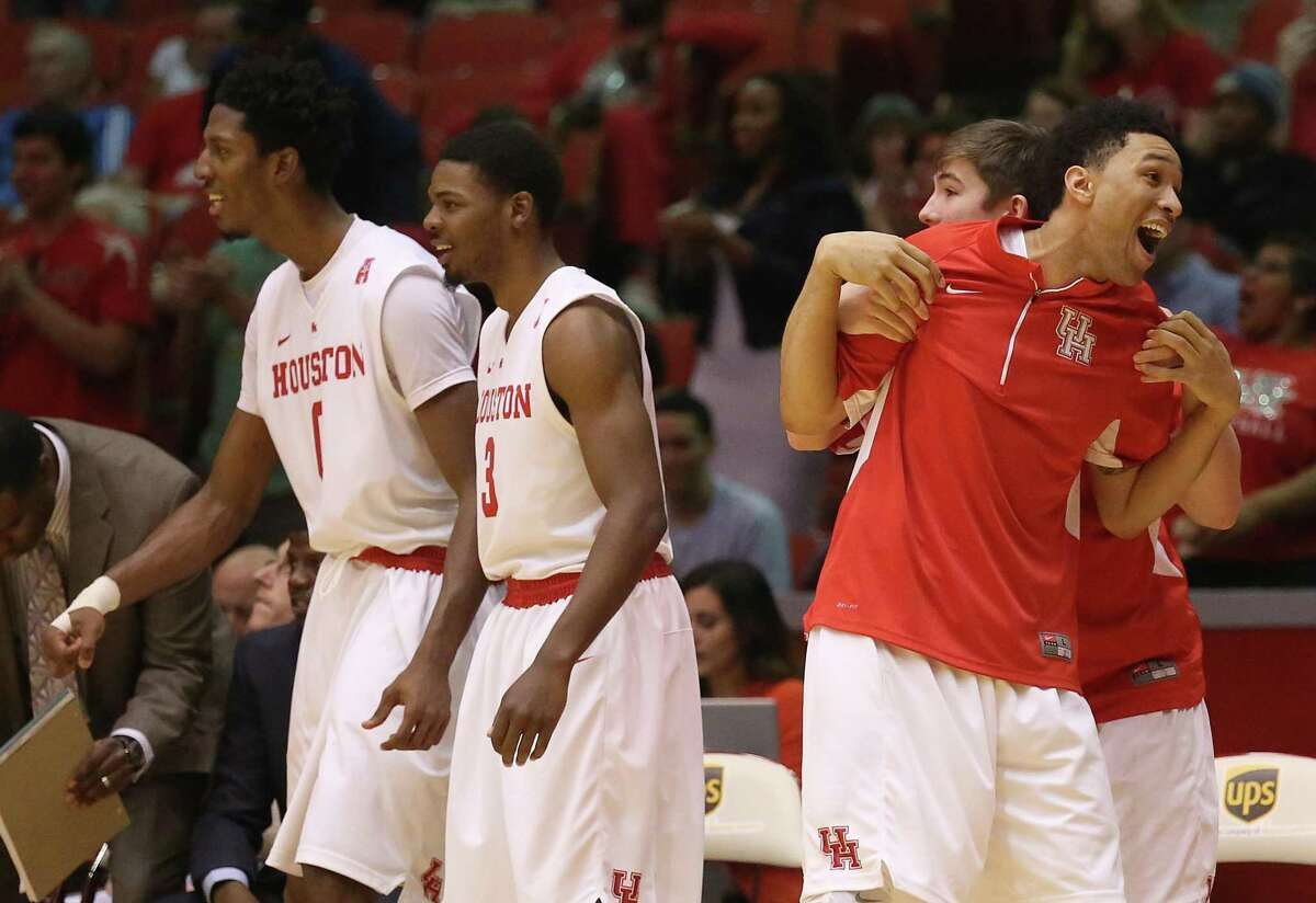 """Danrad """"Chicken"""" Knowles, Cavon Baker and Jherrod Stiggers enjoy a win over UConn, the biggest in a 13-19 season in 2014-15 in Kelvin Sampson's first year at Houston."""
