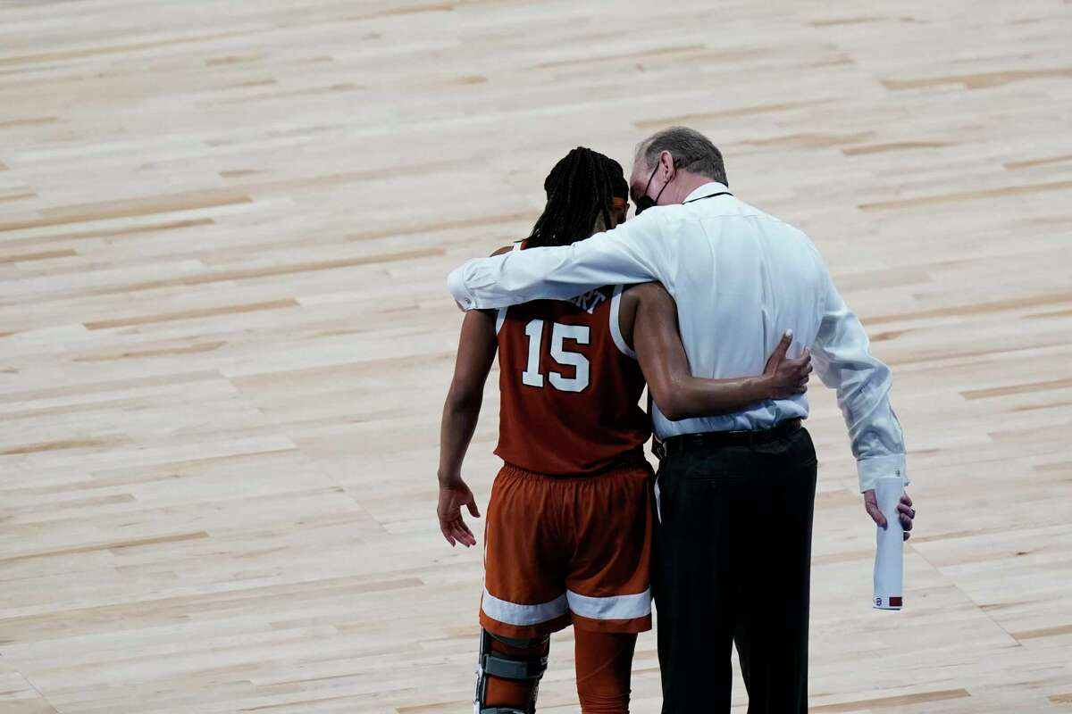 Texas head coach Vic Schaefer talks with guard Kyra Lambert (15) in the final moments of the team's loss to South Carolina in a college basketball game in the Elite Eight round of the women's NCAA tournament at the Alamodome in San Antonio, Tuesday, March 30, 2021. (AP Photo/Eric Gay)