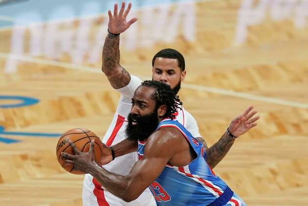 Brooklyn Nets' James Harden drives past Houston Rockets' D.J. Augustin during the first half of an NBA basketball game Wednesday, March 31, 2021, in New York. (AP Photo/Frank Franklin II) Photo: Frank Franklin II, Associated Press / Copyright 2021 The Associated Press. All rights reserved