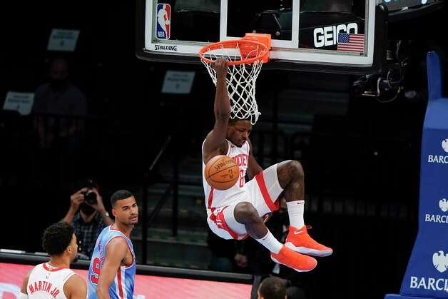 Houston Rockets' Jae'Sean Tate (8) dunks in front of Brooklyn Nets' Timothe Luwawu-Cabarrot (9) during the first half of an NBA basketball game Wednesday, March 31, 2021, in New York. (AP Photo/Frank Franklin II) Photo: Frank Franklin II, Associated Press / Copyright 2021 The Associated Press. All rights reserved