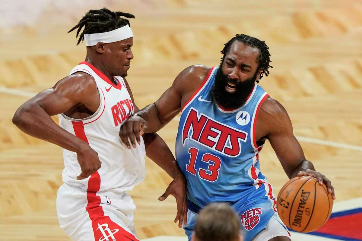 Houston Rockets' Danuel House Jr., left, defends against Brooklyn Nets' James Harden during the first half of an NBA basketball game Wednesday, March 31, 2021, in New York. (AP Photo/Frank Franklin II)