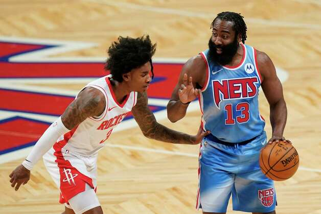 Brooklyn Nets' James Harden (13) calls out to a teammate as Houston Rockets' Kevin Porter Jr. (3) defends during the first half of an NBA basketball game Wednesday, March 31, 2021, in New York. (AP Photo/Frank Franklin II) Photo: Frank Franklin II, Associated Press / Copyright 2021 The Associated Press. All rights reserved