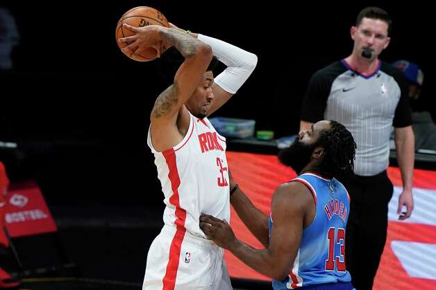 Brooklyn Nets' James Harden (13) defends against Houston Rockets' Christian Wood (35) during the first half of an NBA basketball game Wednesday, March 31, 2021, in New York. (AP Photo/Frank Franklin II) Photo: Frank Franklin II, Associated Press / Copyright 2021 The Associated Press. All rights reserved