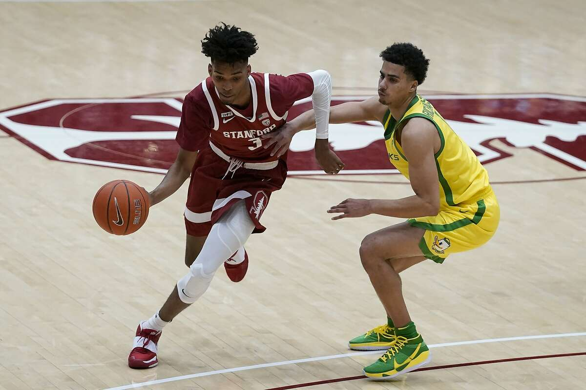 Stanford forward Ziaire Williams (3) dribbles against Oregon guard Will Richardson (0) during an NCAA college basketball game in Stanford, Calif., Thursday, Feb. 25, 2021. (AP Photo/Jeff Chiu)