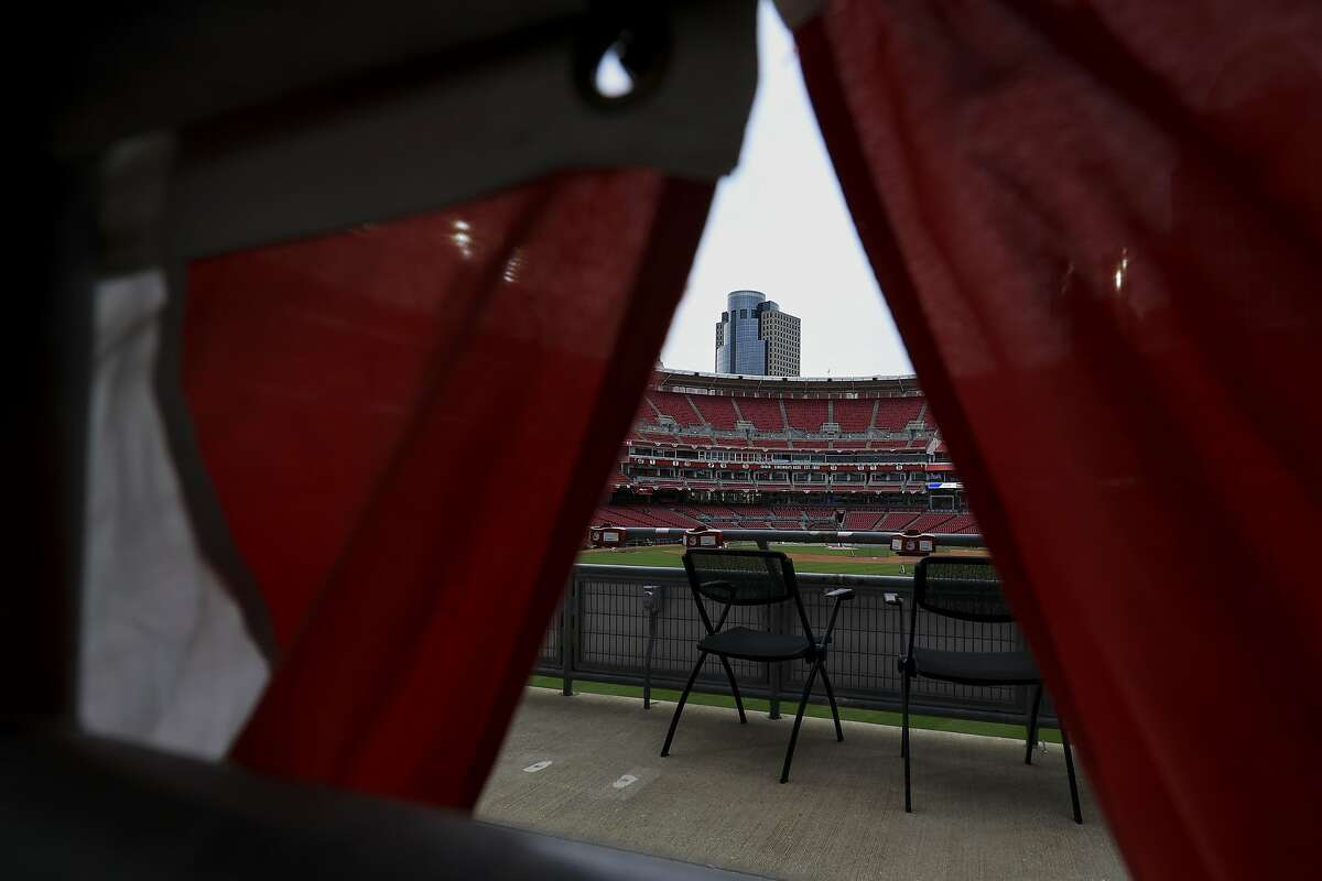 A view of Great American Ballpark seen through bunting during a team workout in Cincinnati. The Cardinals and starter Jack Flaherty face the Reds and Luis Castillo on Opening Day.