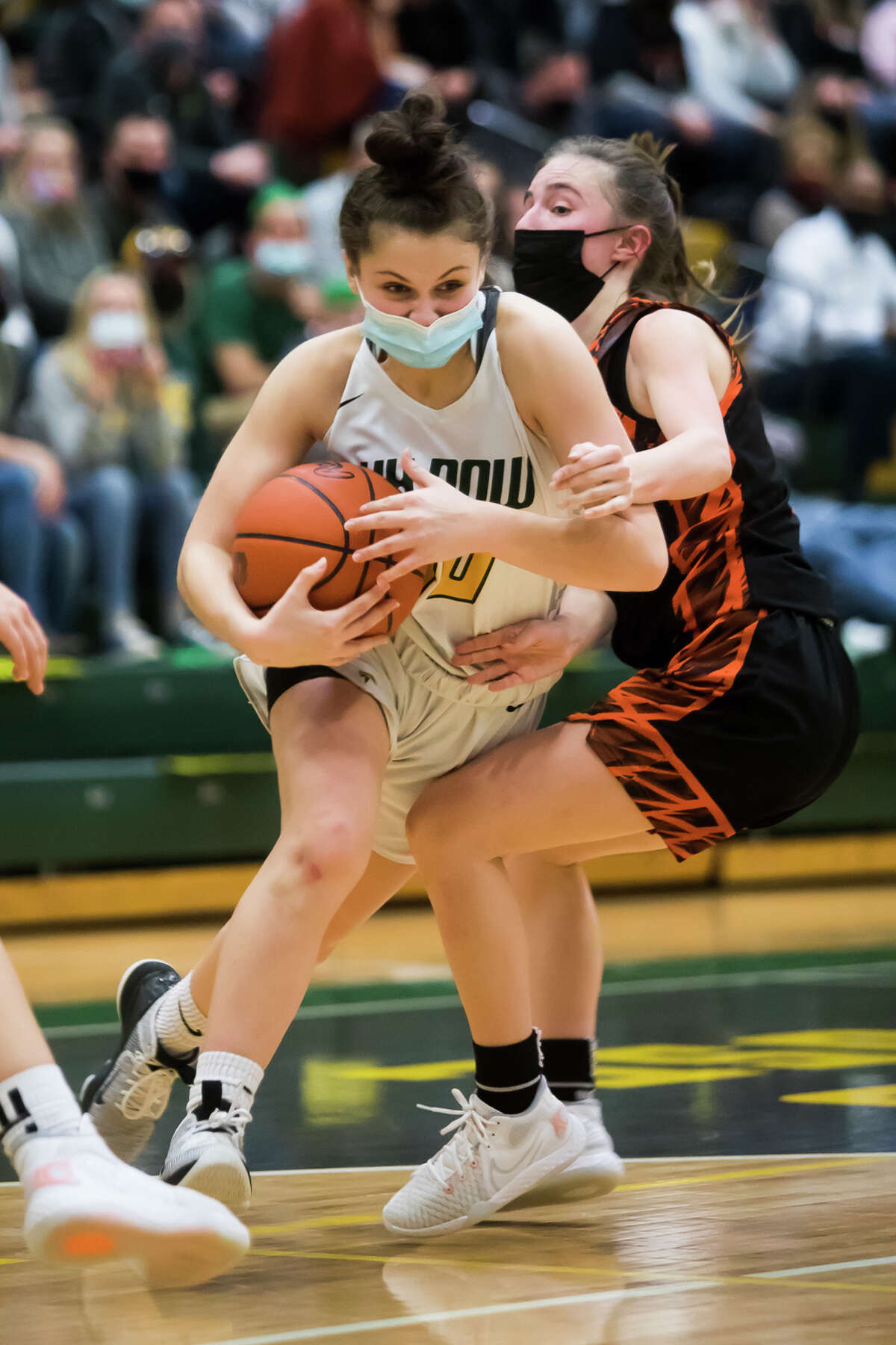 Dow's Chloe McVey dribbles down the court during the Chargers' regional championship victory over Flushing Wednesday, March 31, 2021 at H. H. Dow High School. (Katy Kildee/kkildee@mdn.net)