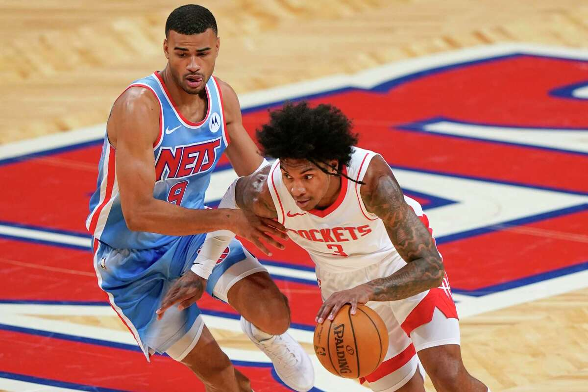 Houston Rockets' Kevin Porter Jr. (3) drives past Brooklyn Nets' Timothe Luwawu-Cabarrot (9) during the second half of an NBA basketball game Wednesday, March 31, 2021, in New York. (AP Photo/Frank Franklin II)