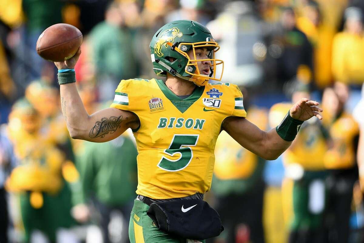 North Dakota State quarterback Trey Lance looks to pass against James Madison in the Jan. 11, 2020, FCS championship game, won by North Dakota State, 28-0.