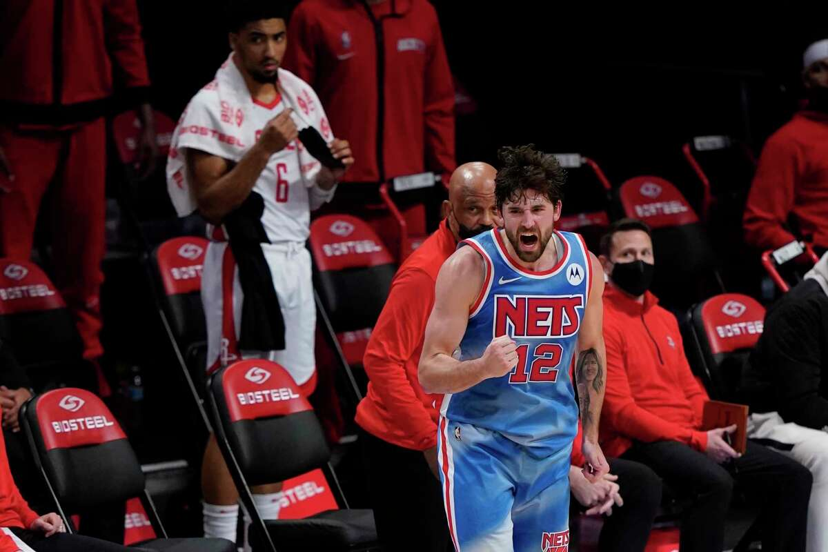 Brooklyn Nets' Joe Harris celebrates after making a 3-point shot during the second half of the team's NBA basketball game against the Houston Rockets on Wednesday, March 31, 2021, in New York. (AP Photo/Frank Franklin II)